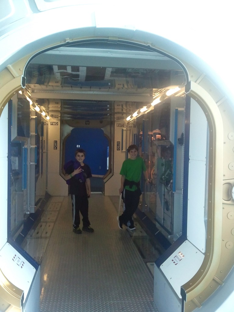 My nephews checking out the full sized module of the International Space Center