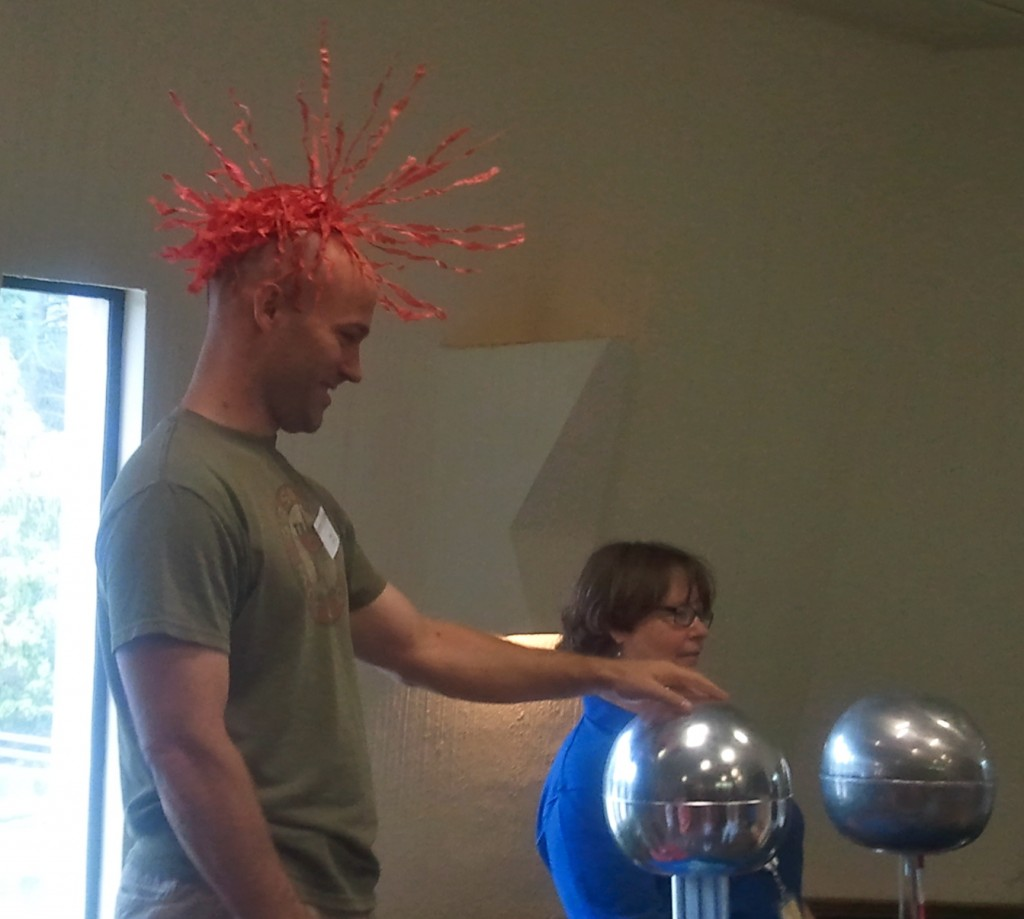 This guy didn't have his own hair to experiment with the Van de Graaff Generator!