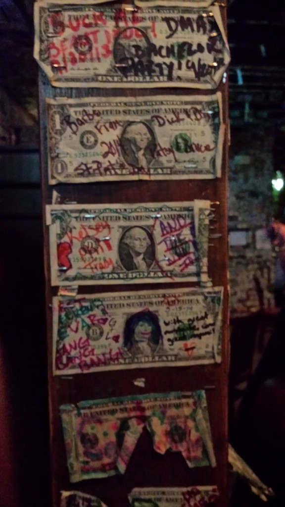 Stapled dollars from previous patrons.