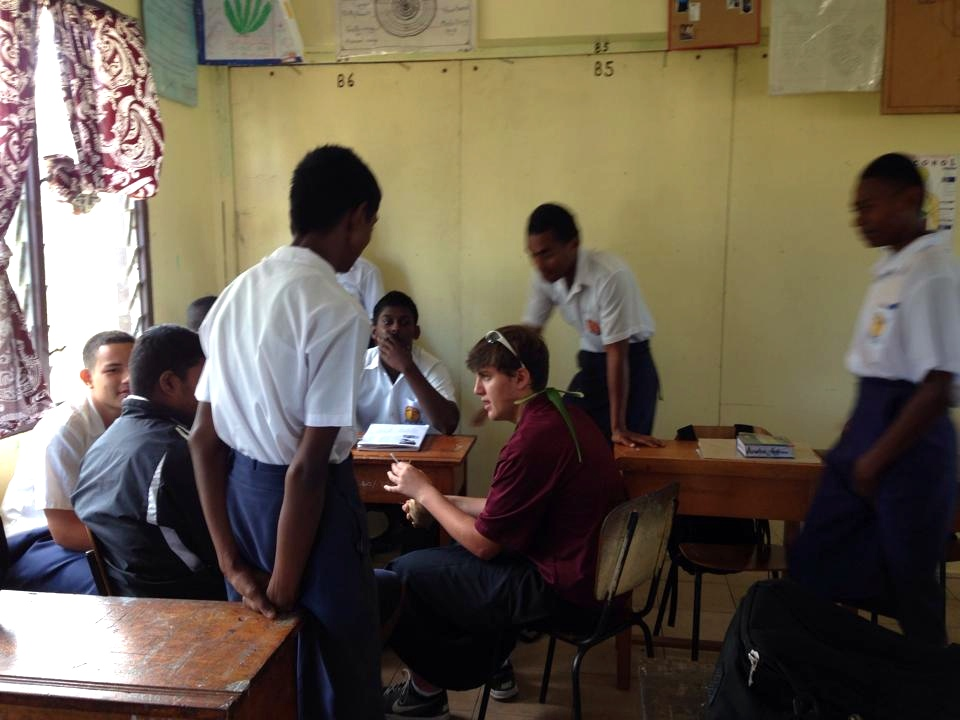 My son spending time at a school in Fiji.  Apparently, they were talking about sports.