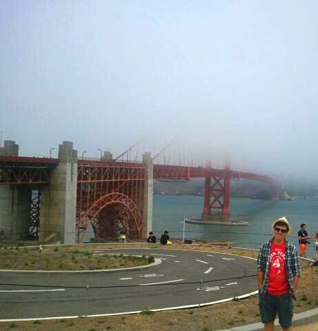 My son in the fog with the disappearing bridge.