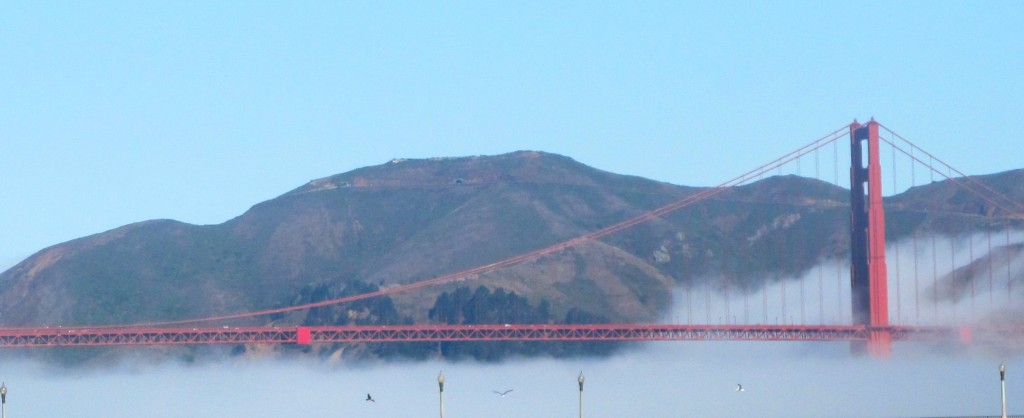 "View from Fort Point earlier in the day.The fog around the Golden Gate Bridge is called ""advection fog."" Such fog forms when humid air from the Pacific swoops over the chilly California current. The bridge has an influence in directing the fog as it pushes up and pours the fog around the bridge."